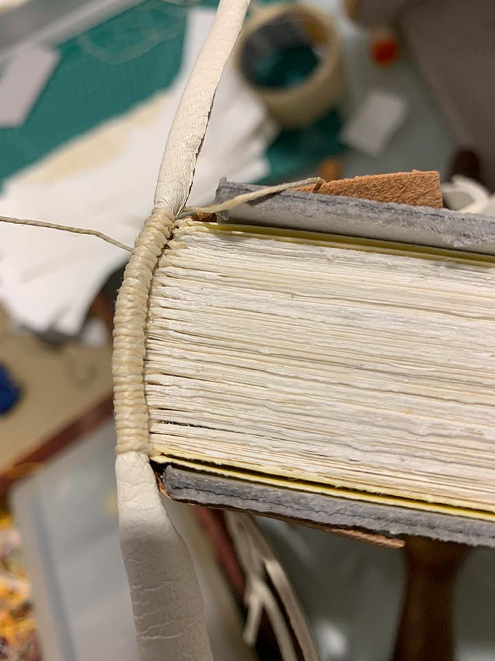Students learning how to make endbands in our 'Historical Bookbinding' course